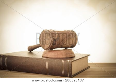 Closeup Wooden Judges Gavel On Wooden Table With Legal Books. Retro Style. Concept Of Law Legal Lega