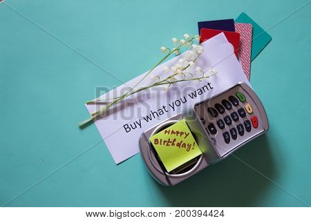 Payment Terminal And A Credit Card As A Gift. Paper With The Text