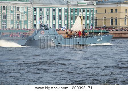 SAINT-PETERSBURG, RUSSIA - JULY 30, 2017: A small amphibious boat D-67 (the Serna project) is transported by the boat of Peter the Great. Opening of the solemn parade in honor of Navy Day