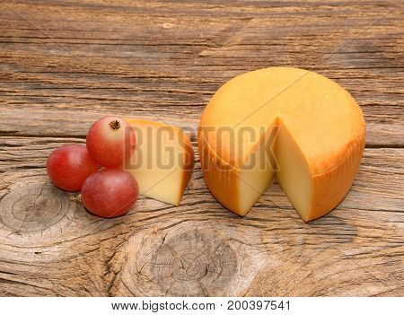 Cheese wheel isoalted on wood in studio