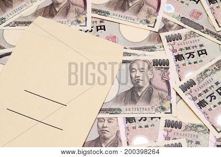 Japanese money on salary envelope, view of cash money yen