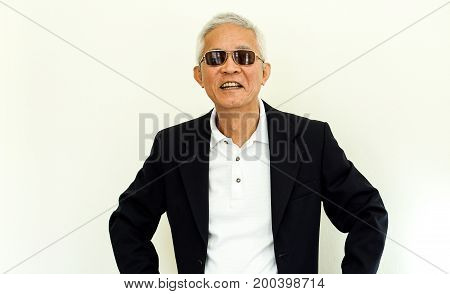 Asian Senior Man Casual Business Suit With Happy Face And Sunglasses