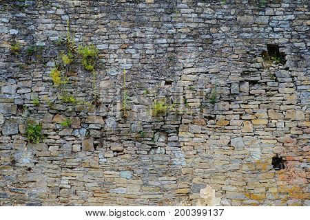 Texture Of Old Medieval Castle Wall With Loophole Made From Gray Stones
