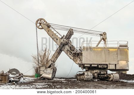 Large crawler bucket excavator in heavy industry