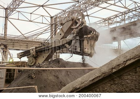 Work of a large bucket excavator in heavy industry