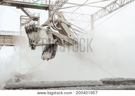 Big bucket excavator heavy industry in the fog. Outdoor hot industrial shop.