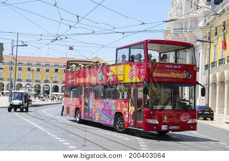 Lisbon PORTUGAL City sightseeing bus at Praca do Comercio in Lisbon. June 1 2017. Lisbon hop-on hop-off bus for discover the capital of Portugal