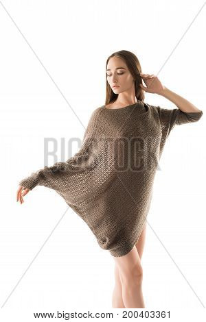 Attractive sexy blonde wearing beige knitted gown isolated view
