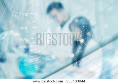 blurred background Two Laboratory scientist working at lab with test tubes with science abstract graphic foreground.