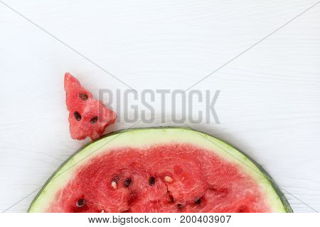 Red sweet Christmas tree on a hill of watermelon slices / mouthwatering landscape with mood