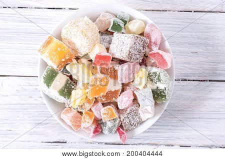 Multicolored Sweets In A White Plate.