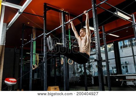 Bar Exercises. Workout In Dark Gym