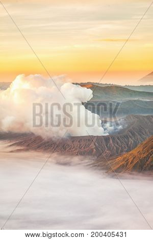 Landscape of Mount Bromo volcano (Mt.) in high angle view with sunrise from viewpoint on Mount Penanjakan located in Bromo Tengger Semeru National Park East Java Indonesia.