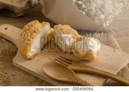 Choux Cream On Plate. Cream Puffs Filled Vanilla And Milk Custard