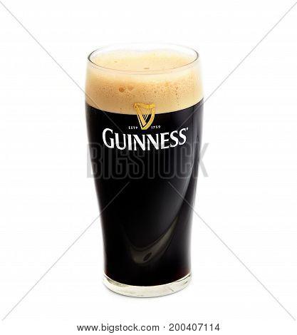 POLTAVA, UKRAINE - APRIL 4, 2017: Pint of Guinness, the popular Irish beer on a white background