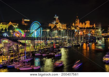SZCZECIN, WEST POMERANIAN / POLAND - 2017: Final Tall Ships Races. Sailing ships and yachts at the lighted Chrobry Embankment