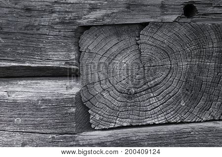 The texture of a wooden board is smashed into another wooden board with a hole. Gray photo. Horizontal photo wallpaper