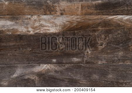 The texture wooden brown boards adhere tightly to each other. Even without holes with cracks. Horizontal photo wallpaper