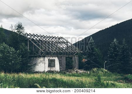 old wooden house with no roof in mountains