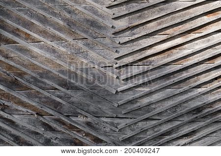 The texture gray boards nailed to the wall of wood boards. Horizontal photo wallpaper
