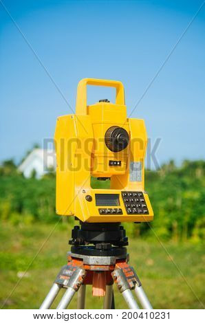 Surveyor equipment theodolite on tripod on future construction site