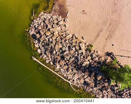 Aerial view of ocean beach. Sand beach and sea view from above. Beach aerial view of ocean water and sand shore. Aerial shot of beach