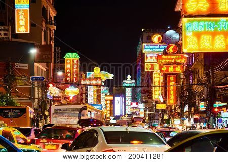 CHINATOWN BANGKOK THAILAND - 21 July 2017: Cars and transports drive on Yaowarat road at the main street of China town. with the signage and advertisement shop and restaurant lighting background in the night shot.