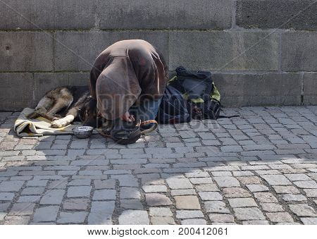 Beggar with his dog on Charlese bridge, Prague, Czech Republic