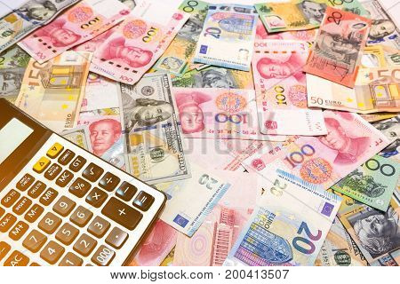 World Money Background Us Dollar, Australian Dollar, Chinese Yuan And Euro With Calculator And Copy