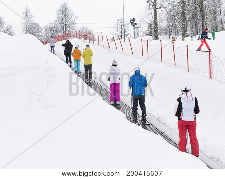 Sochi - March 28 2017: People go on a ski travolator to climb to the top of the mountain March 28 2017 Sochi Russia