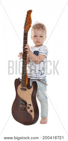 Cute little boy with electric guitar on white background