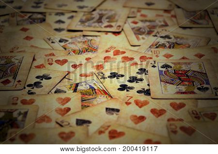 many old Poker cards close up photo