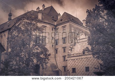 Panorama of old Cesky Krumlov castle in foggy sky infested by ghosts, Bohemia, Czech Republic