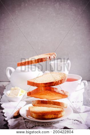 Levitation food concept - toasts for breakfast flying