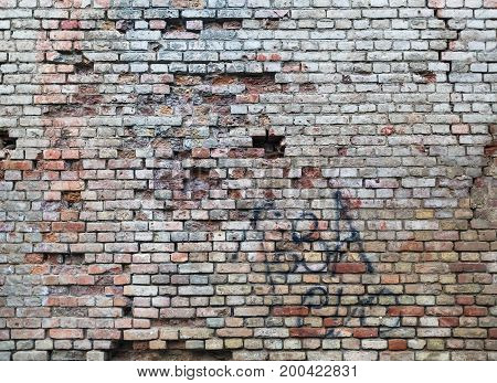 Brick wall texture. Old brickwork background with damaged surface.