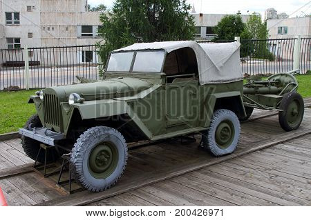 Moscow Russia - July 19 2017: GAZ-67 passenger car with towed mine-thrower on grounds of weaponry exhibition in Victory Park at Poklonnaya Hill.