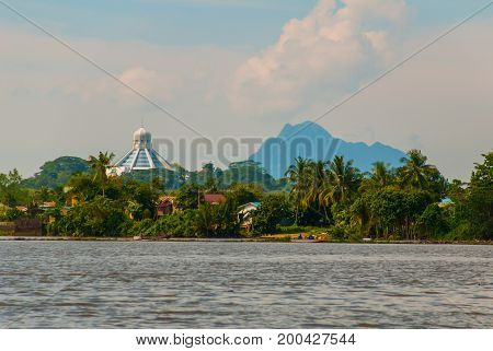 Landscape View Of The City And Sarawak River. Museum Of Cats, And A Mountain On The Horizon. Kuching
