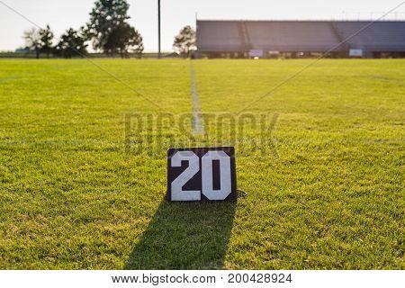 the twenty yard line marker and the twenty yard line