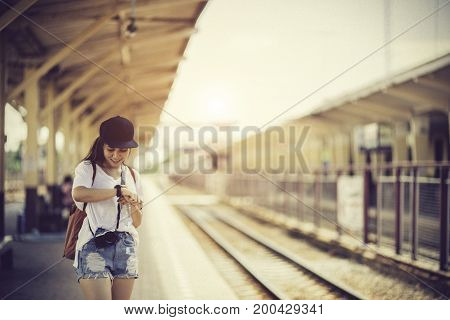 Traveler Woman Walking And Waits Train On Railway Platform