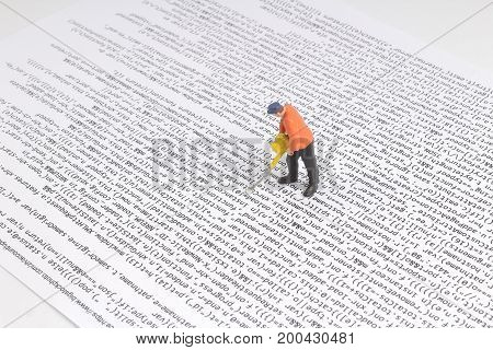 Under Construction Worker Figurines Working On Code.