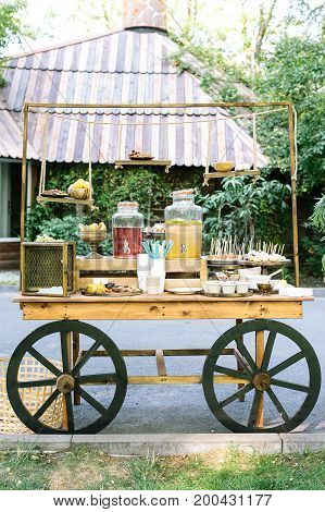 healthy llifestyle, vegetarianism, food concept. amount of various marvelous and healthy treats with drinks in the customer of grocery shop made in the vintage style with decorative wheels