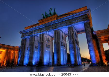 illuminated brandenburger tor in germany in the evening
