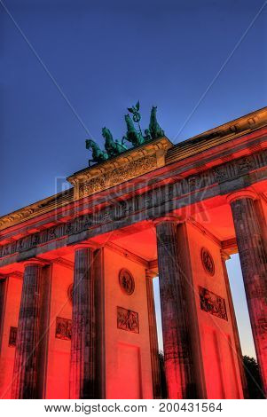 illuminatet brandenburger tor in germany in the evening
