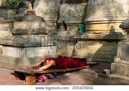 Buddhistic monk prayer. Mahabodhy Temple in Bodhgaya Bihar India
