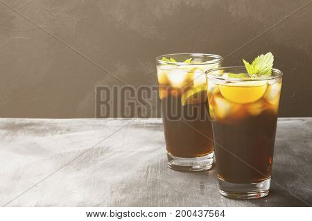 Two Glasses Of Cocktail Cuba Libre On A Dark Background. Copy Space. Food Background. Toning