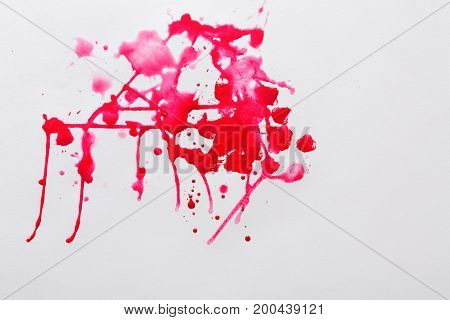 Abstract watercolor paint splash background. Bright red spots on paper texture, top view, modern art