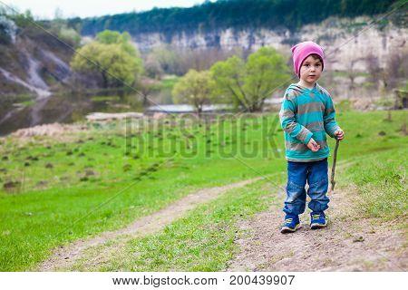A Boy Walks Through A Meadow.