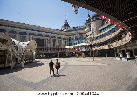 Kiev Ukraine - June 18 2017: Couple is at noon in an empty entertainment and shopping center