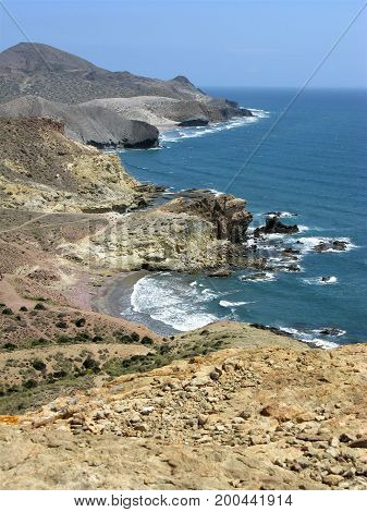 Rocky coastline with bays and a headland in the Cabo de Gata Natural Park, Spain