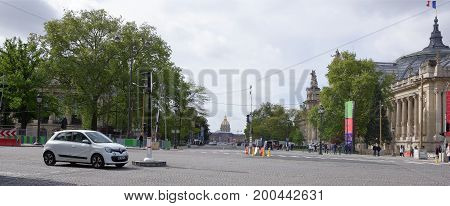 ParisFrance- April 30 2017: Grand Palace on Winston Churchill Avenue. Moving people and transport